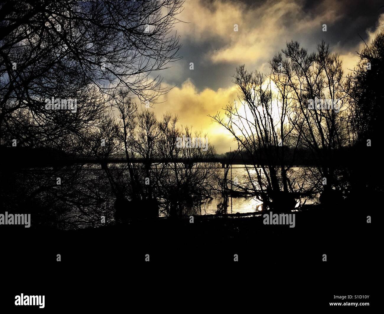 Sunrise over water - Stock Image