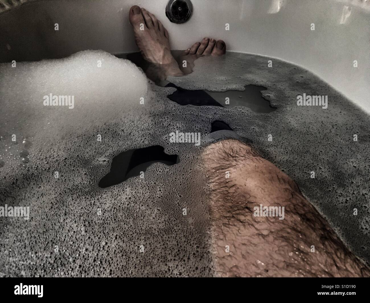 Marathon Runner's recovery bath - Stock Image