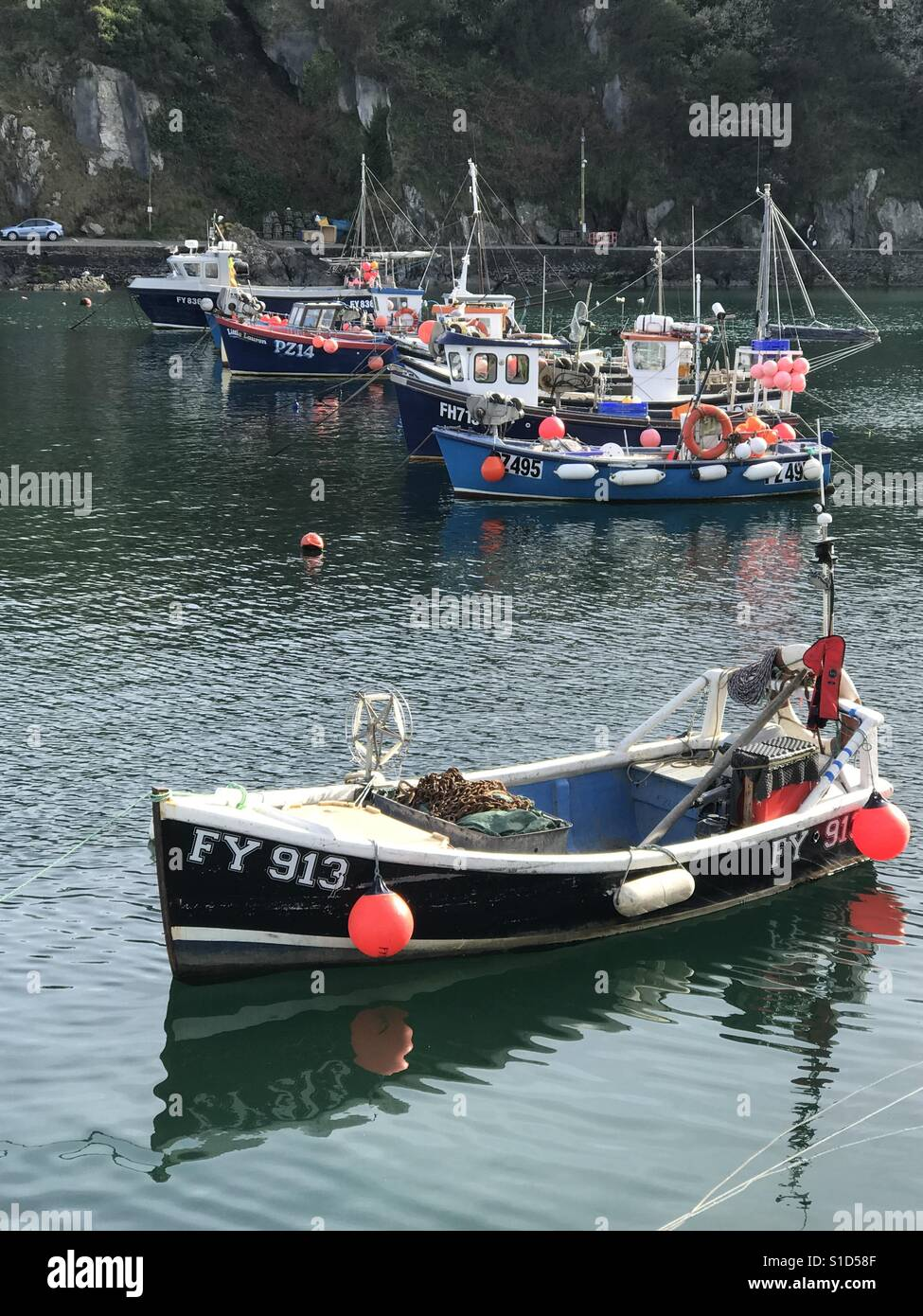 Fishing boats lined up in harbour - Stock Image