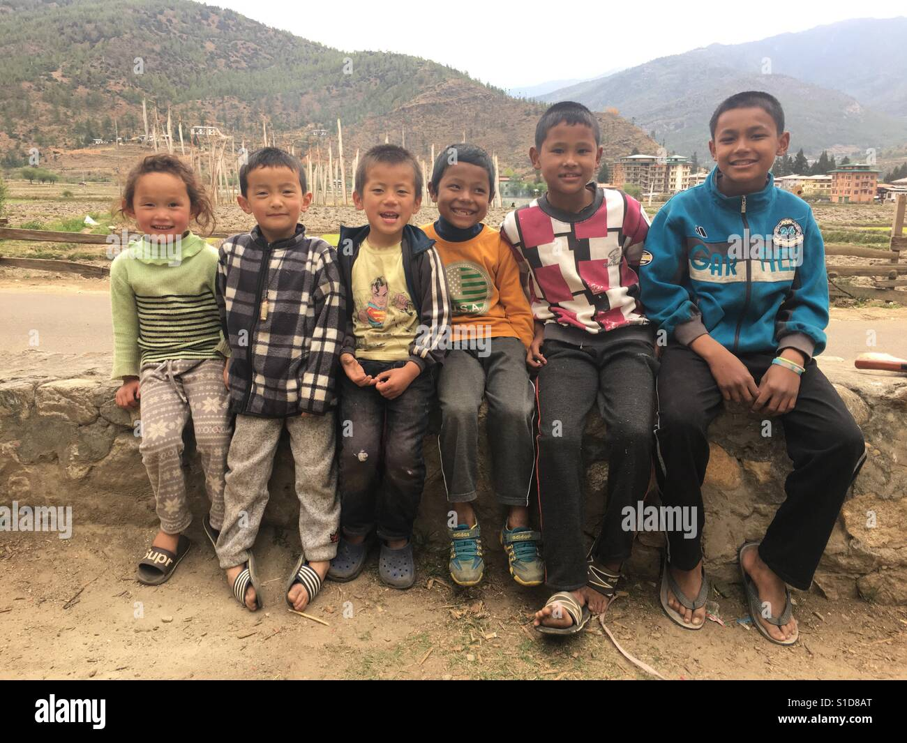 Diverse kids of different religions together bonded with beautiful friendship in Bhutan. - Stock Image