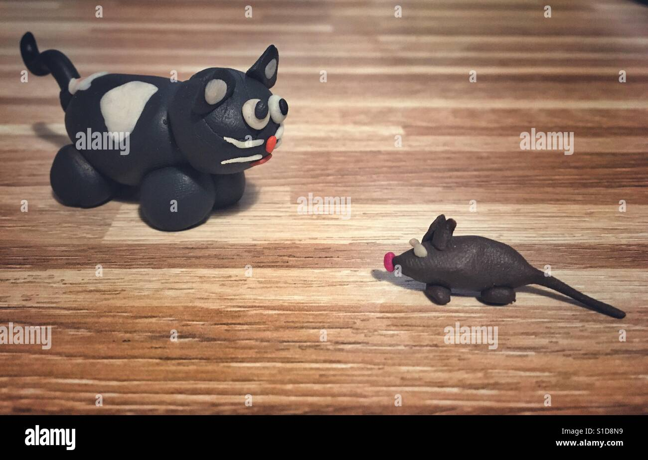 Cat and mouse made of modelling clay - Stock Image