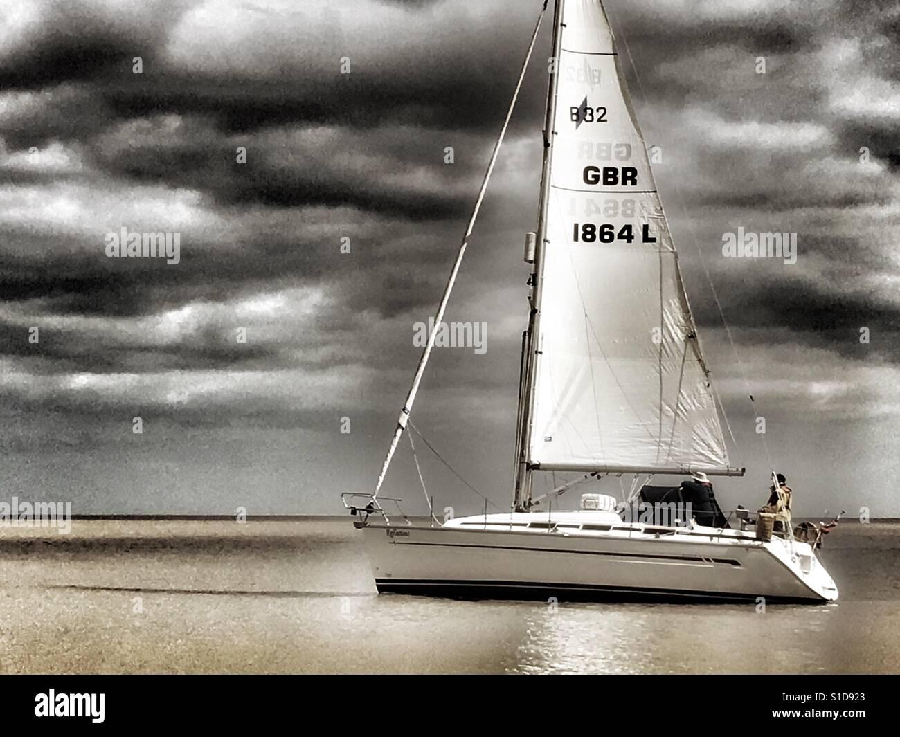 Sailing into the river Ore, Shingle Street, Suffolk, England. - Stock Image