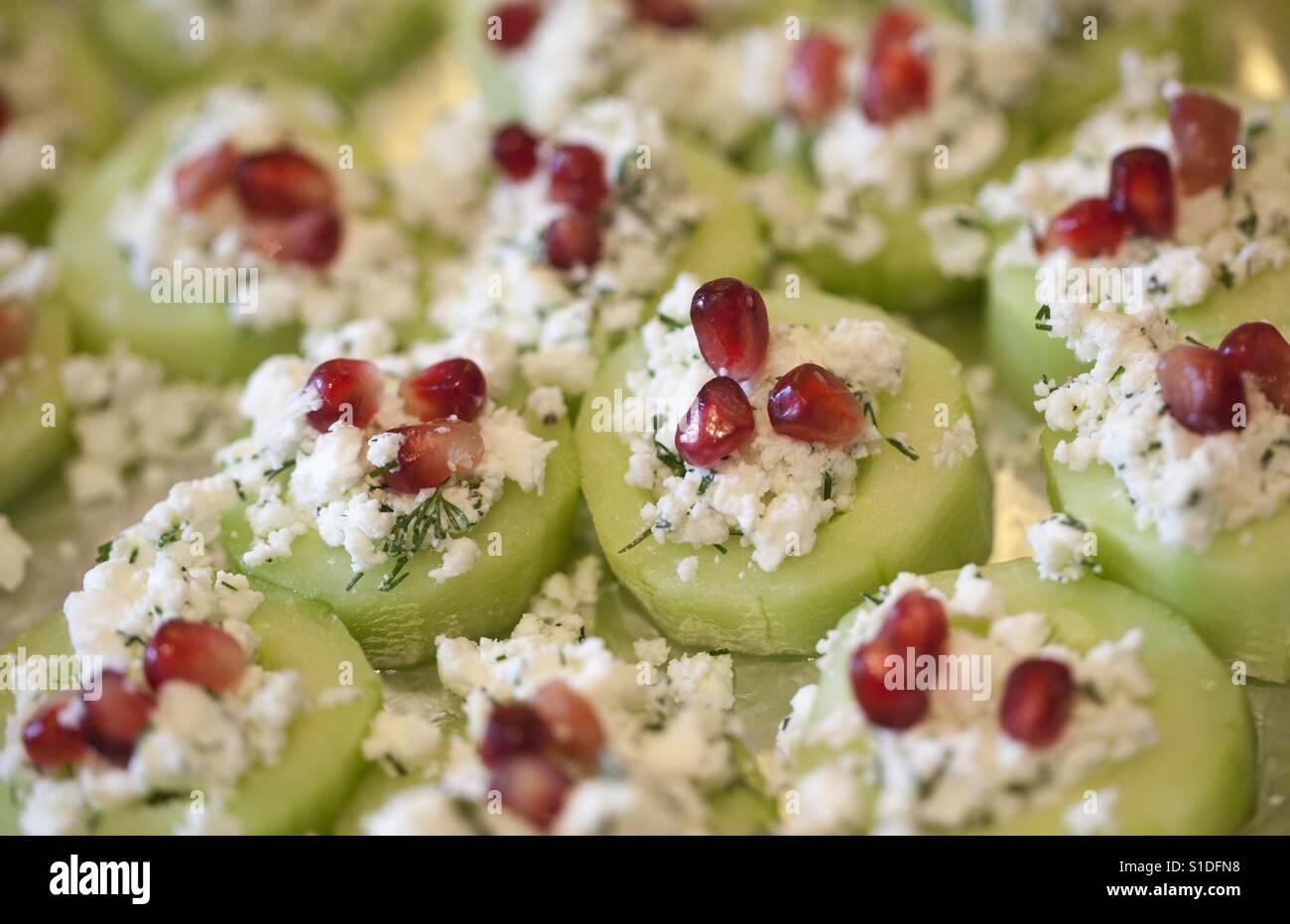 Cucumber pomegranate and feta canapés - Stock Image