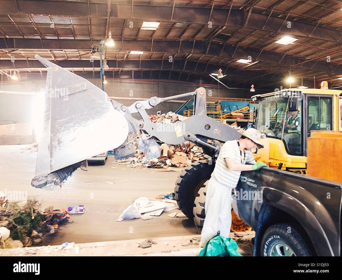 Santa Fe Landfill worker heavy equipment - Stock Image