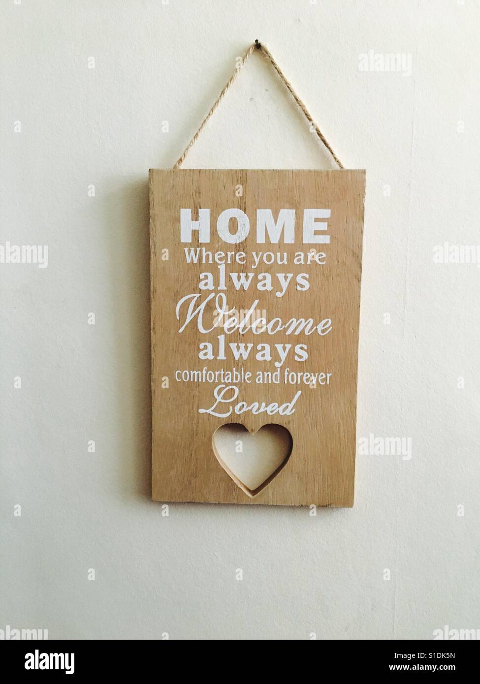 Home sweet home wooden heart. - Stock Image