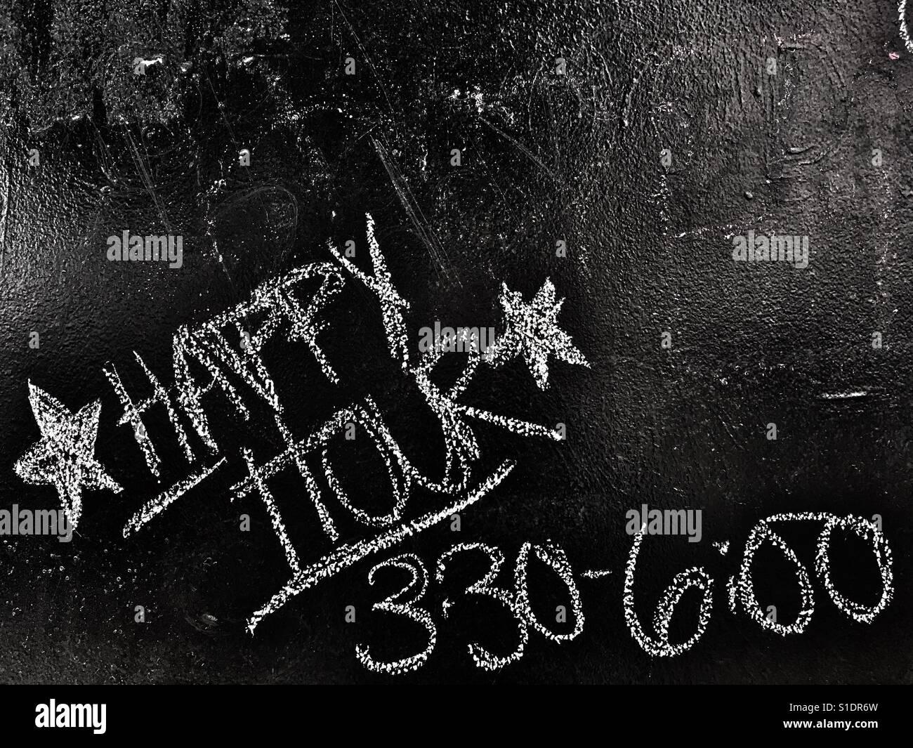 Happy hour on bar chalk board Stock Photo