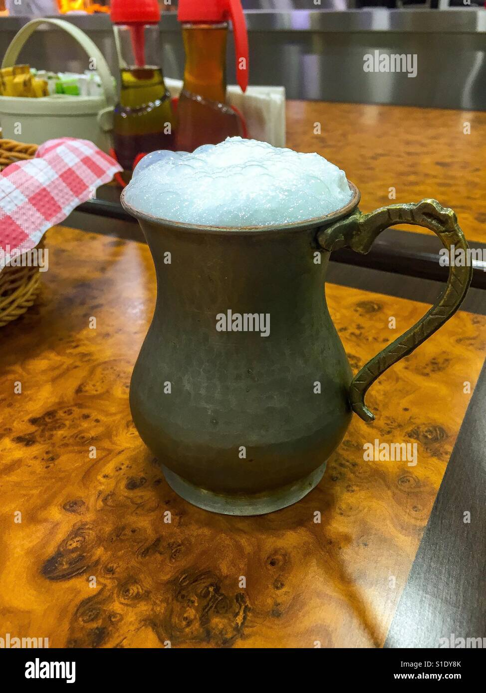 Middle Eastern drink (Laban Ayran) in a traditional cup - Stock Image