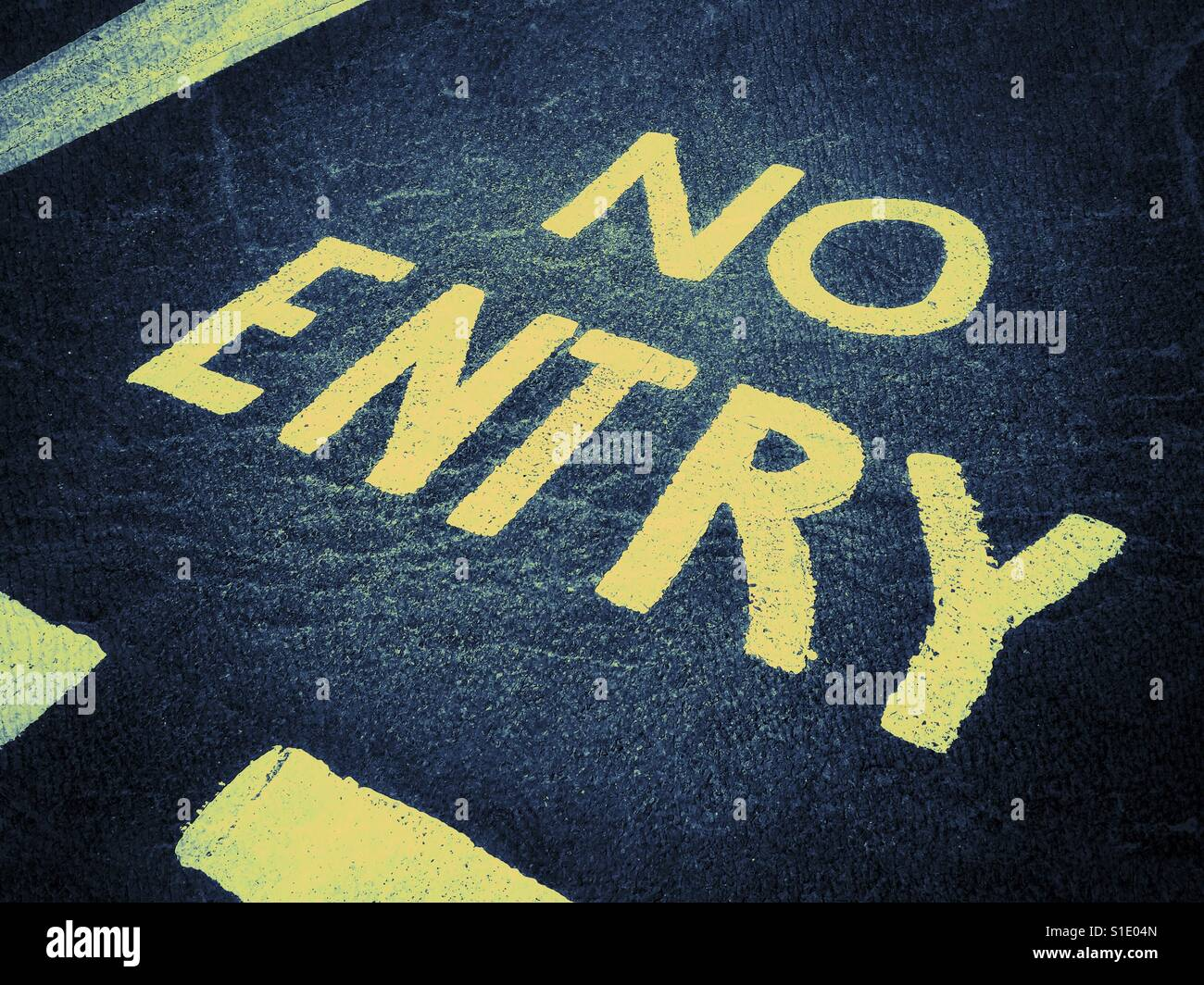 NO ENTRY. Words painted on a road instructing motorists, cyclists, buses and travellers they are not permitted to - Stock Image