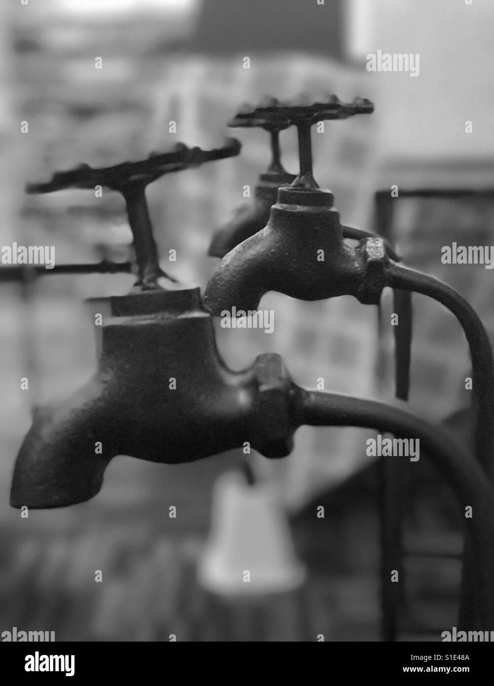 Vintage metallic water taps.. - Stock Image