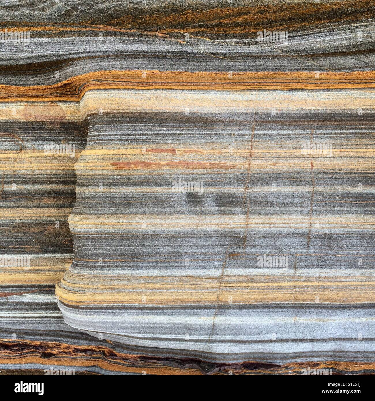 colorful bands and layers of sedimentary rock stock photo