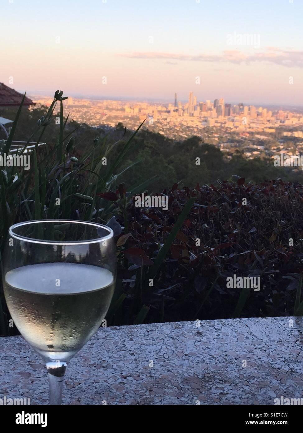 Wine above Brisbane at sunset - Stock Image