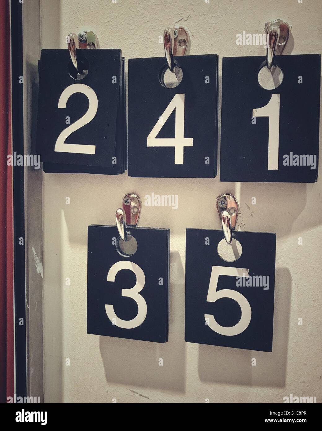Fitting room numbers for items - Stock Image