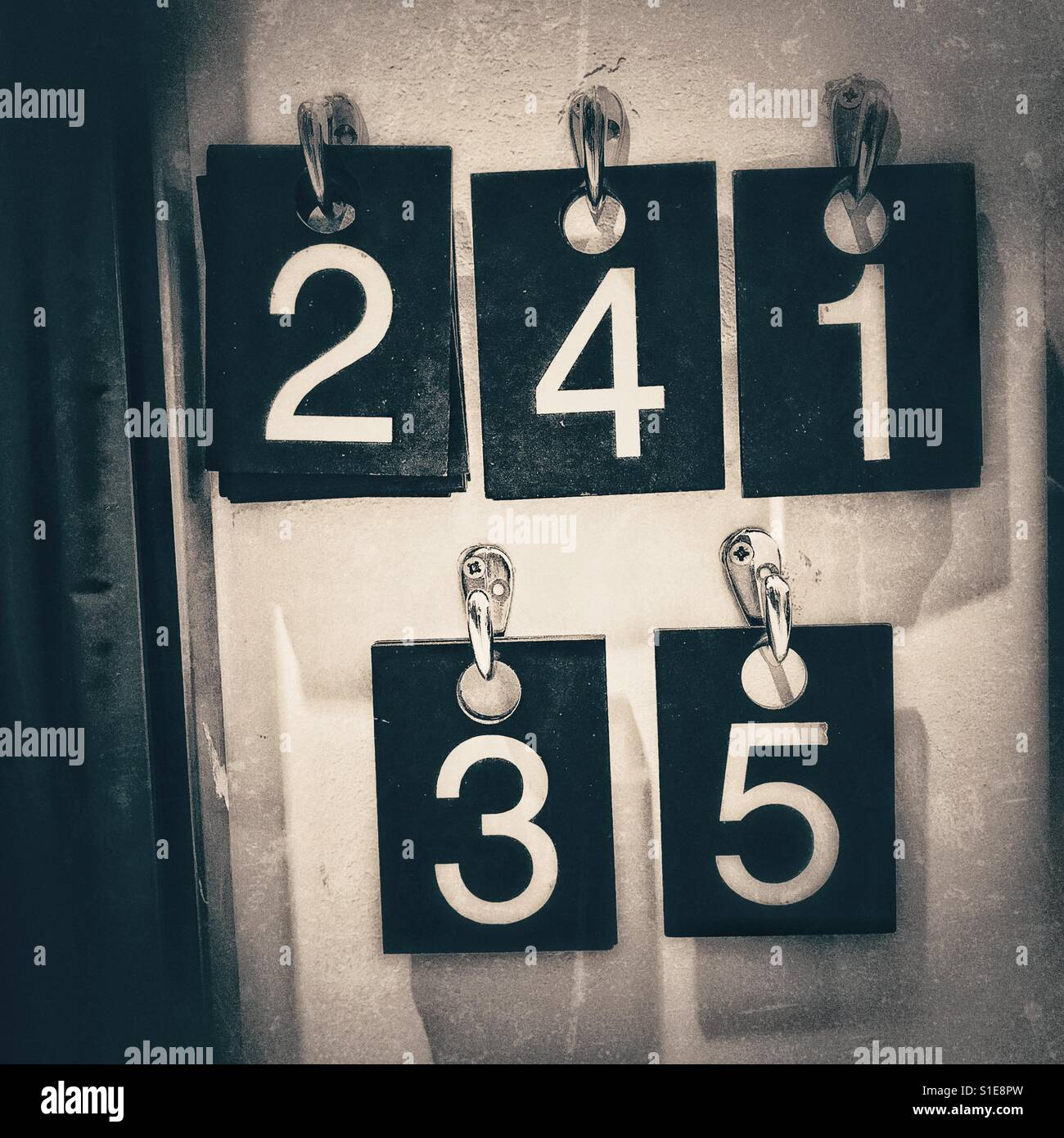 Fitting room numbers for clothing items in black and white - Stock Image