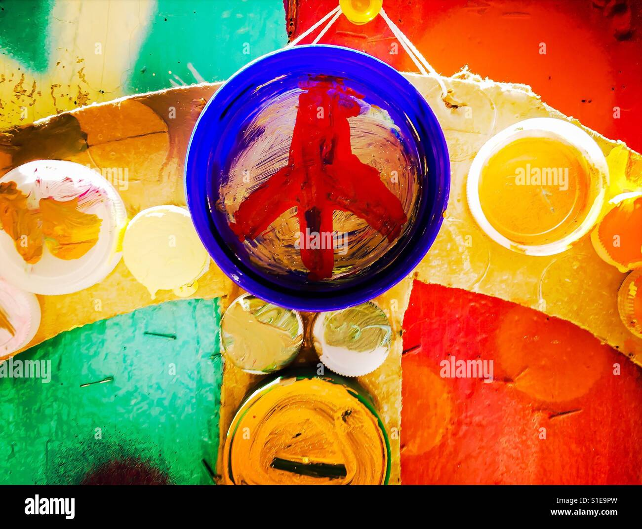 Peace - colorful hand painted peace sign on bottle cap - Stock Image