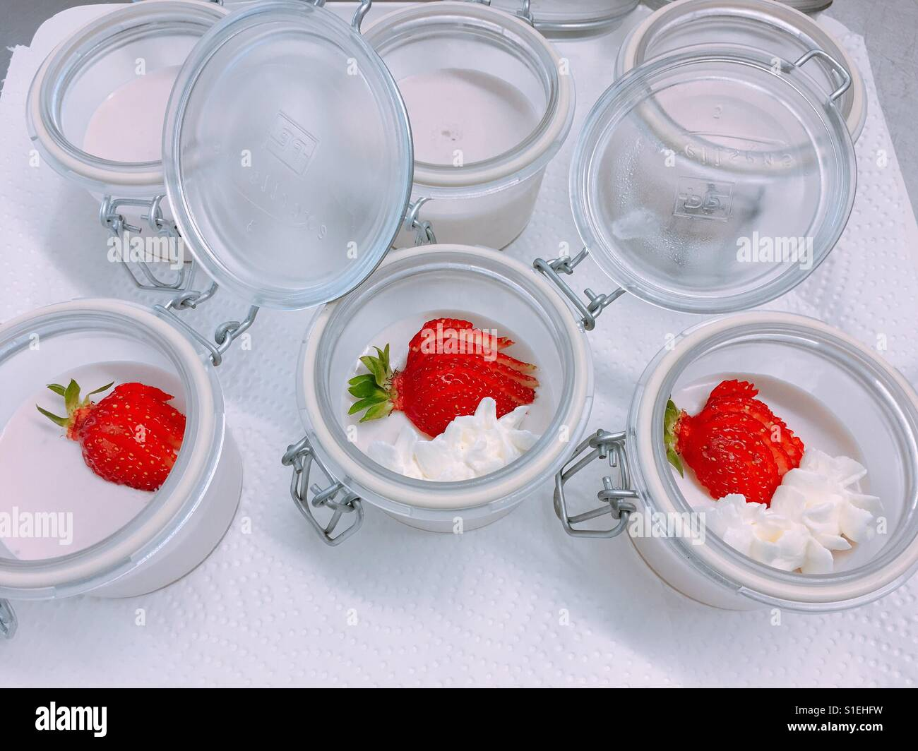 Jars with whipped cream and strawberries / Bayrisch Creme mit Erdbeeren - Stock Image