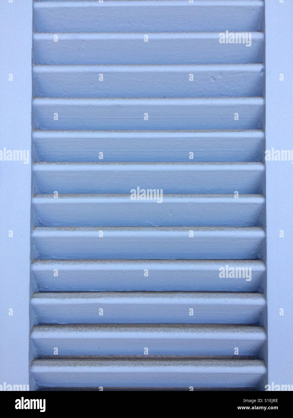 Blue Slatted Door   Stock Image