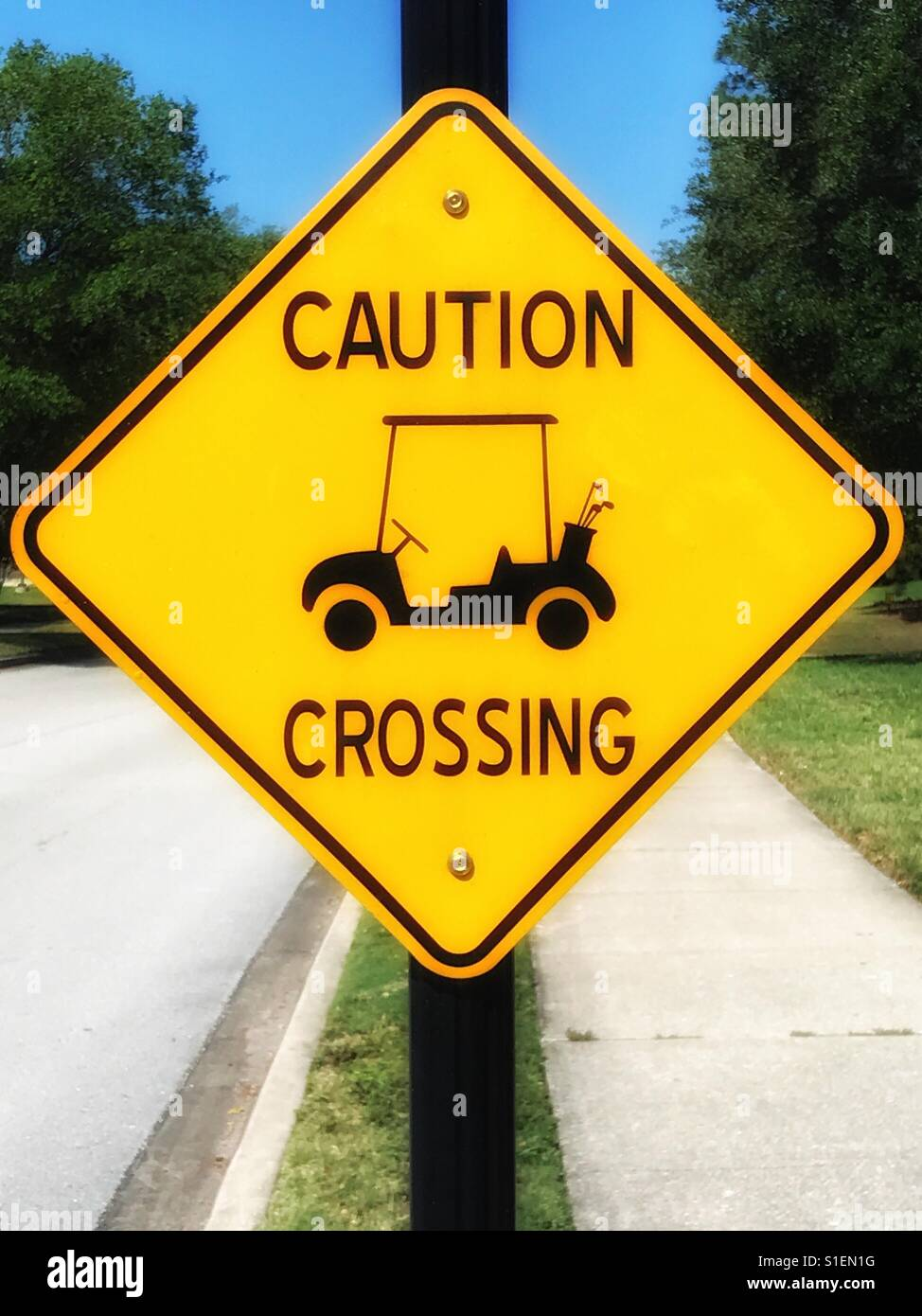 Caution Golf Cart Crossing sign - Stock Image