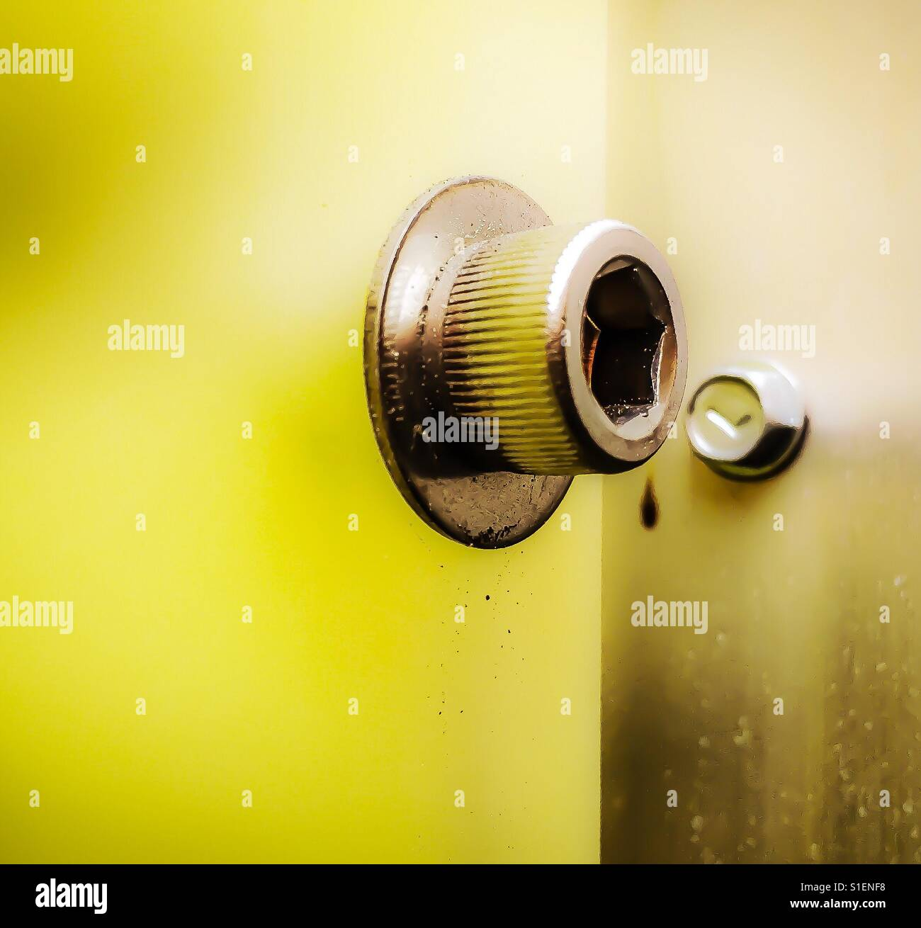 Yellow - connection of nuts, bolts, hardware Stock Photo