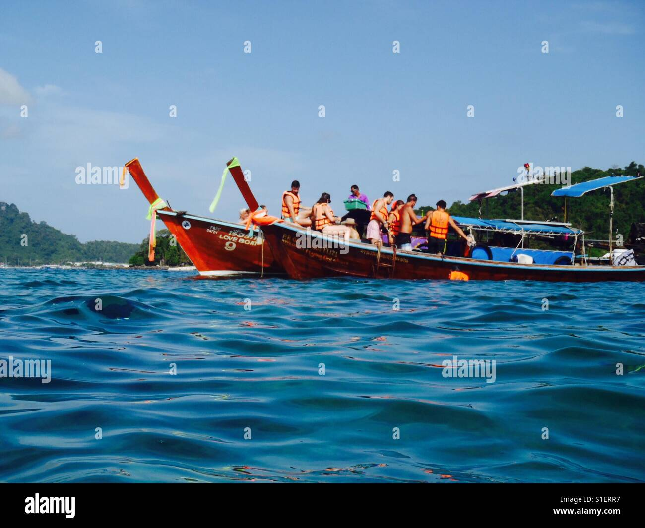 Boat of people - Thailand, Edited - Stock Image