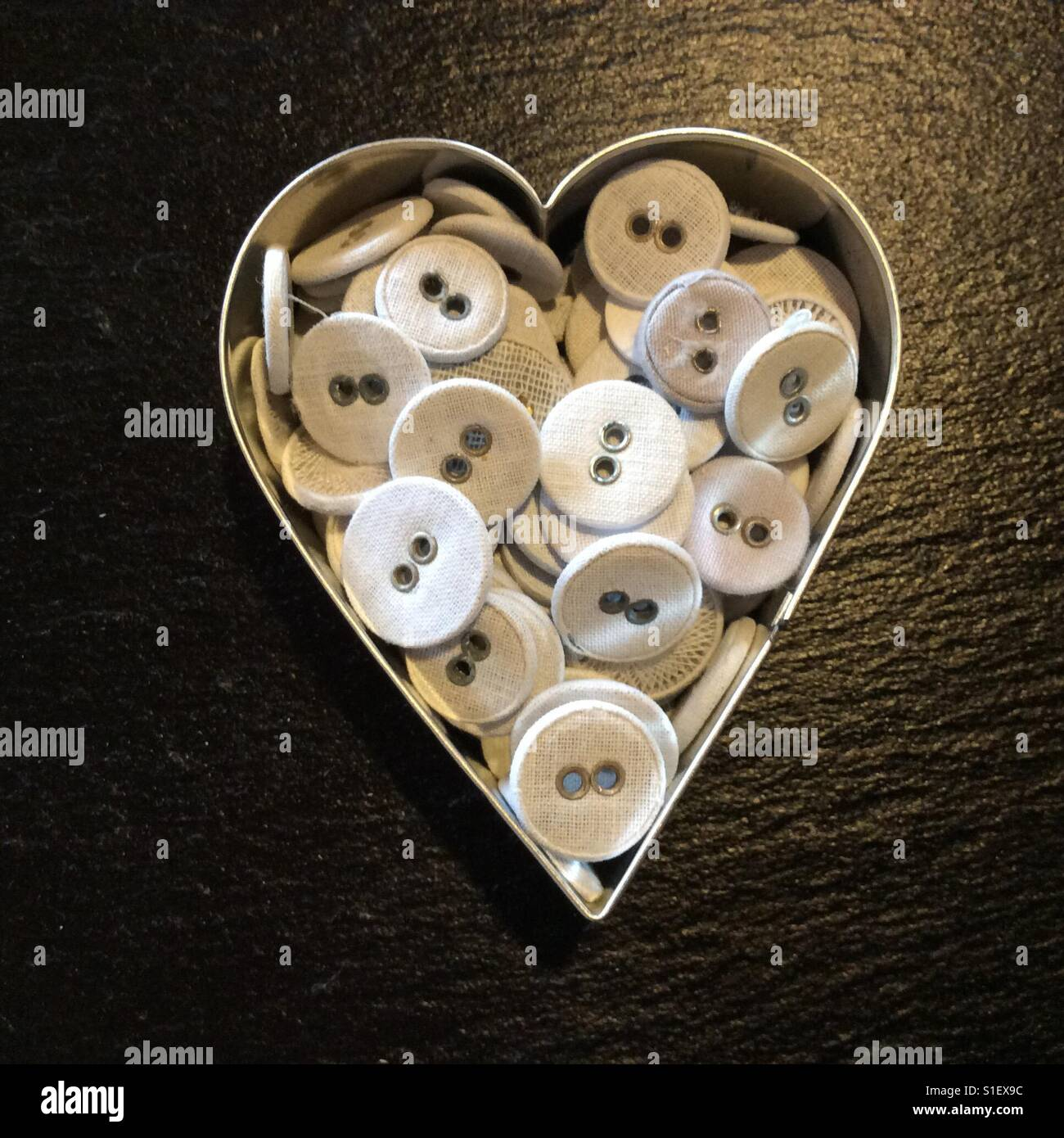 Heart shaped box with white buttons - Stock Image