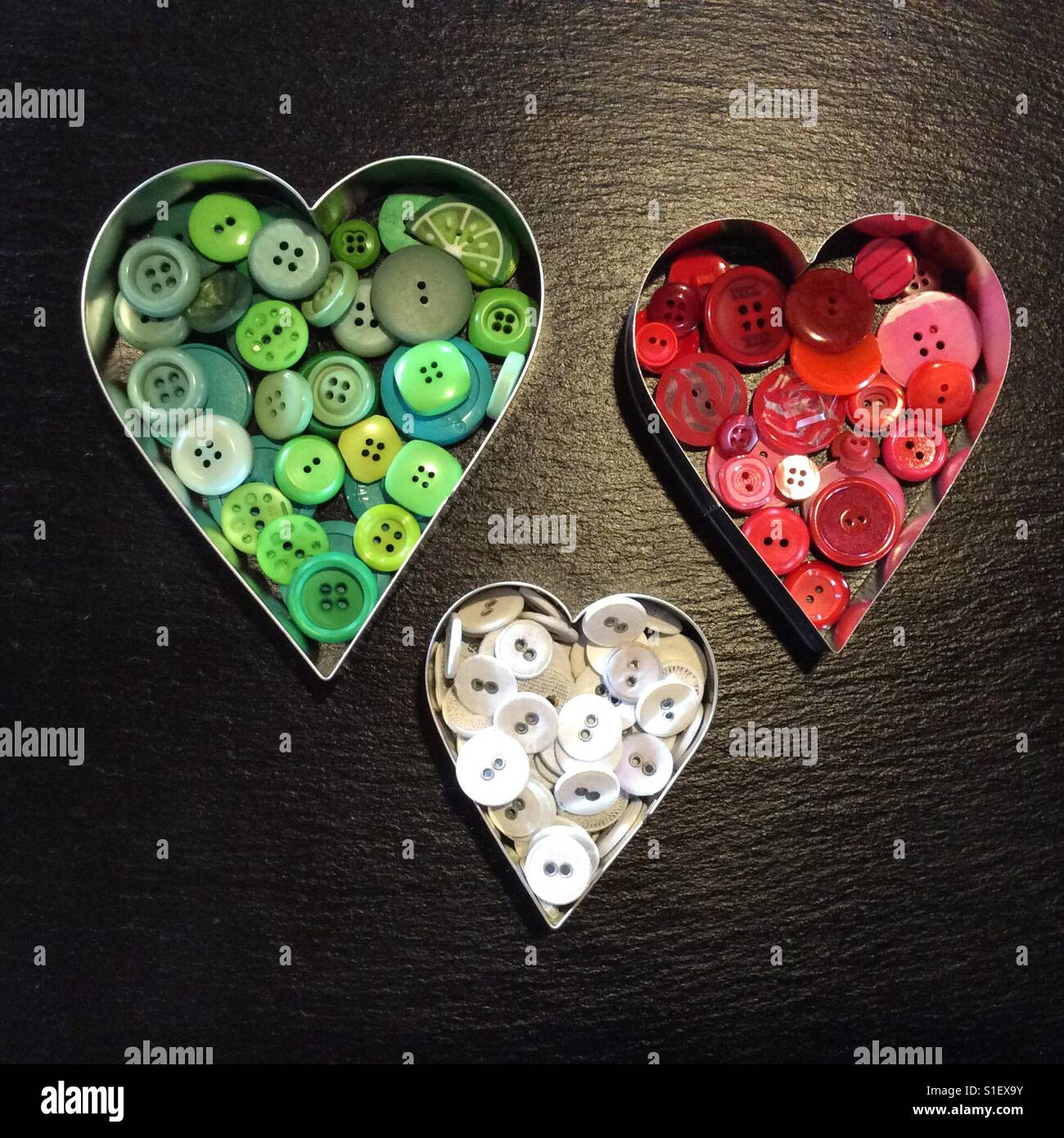 Collection of green, red and white buttons in heart shaped