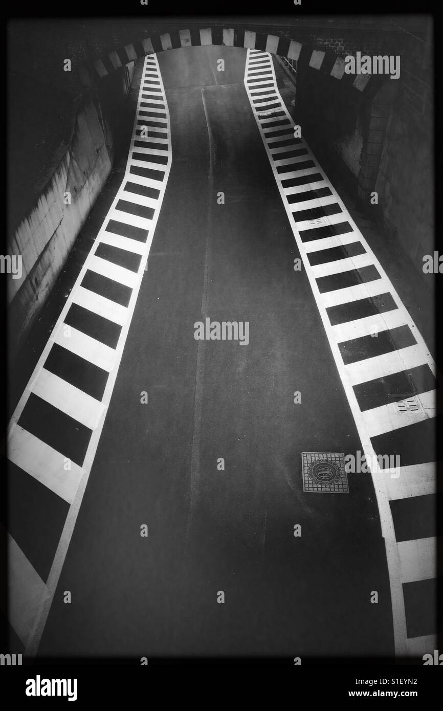 Tunnel road direction way air view signs abstract composition contrast empty bottleneck difficulty obstacles - Stock Image