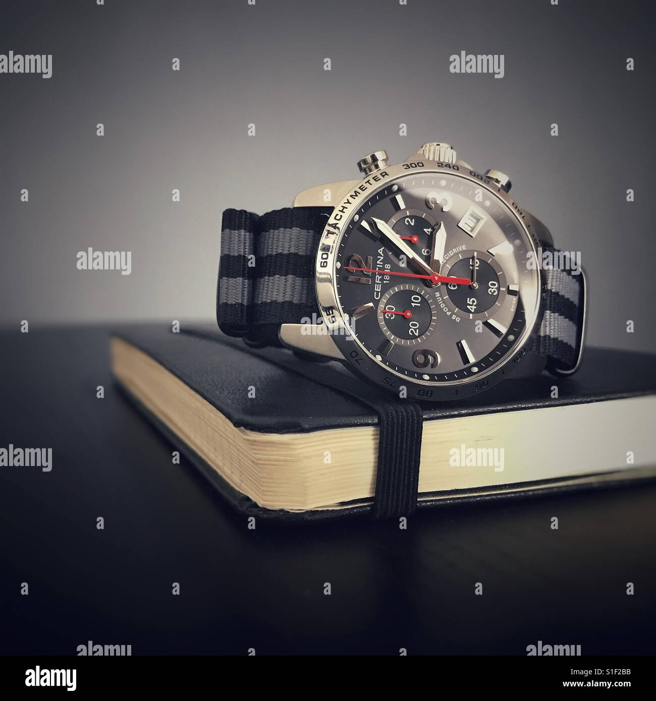Sports wristwatch on a notebook - Stock Image