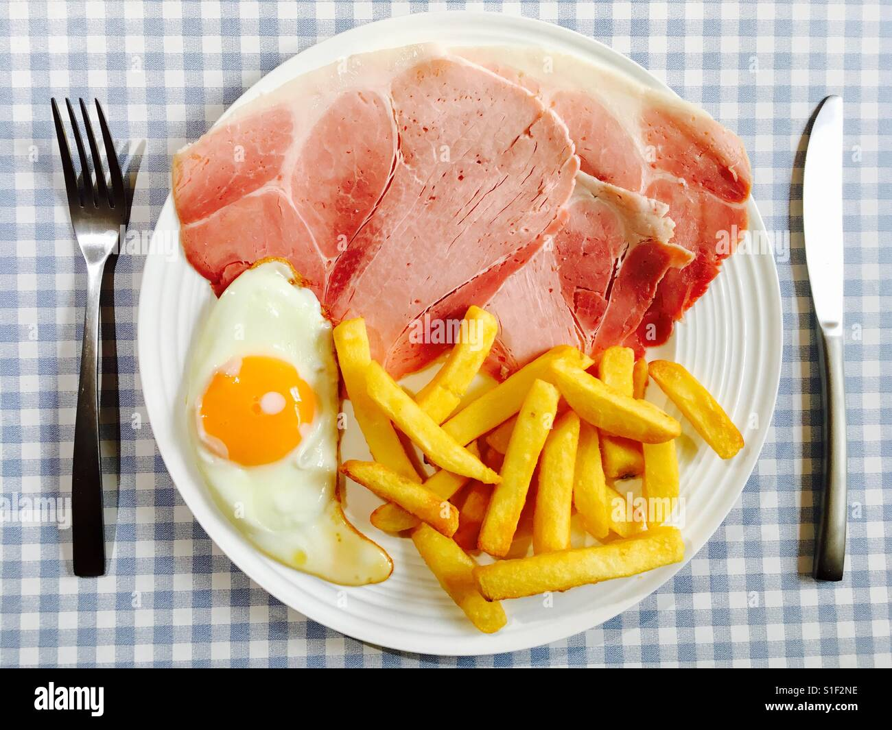 Ham, fried egg and chips Stock Photo