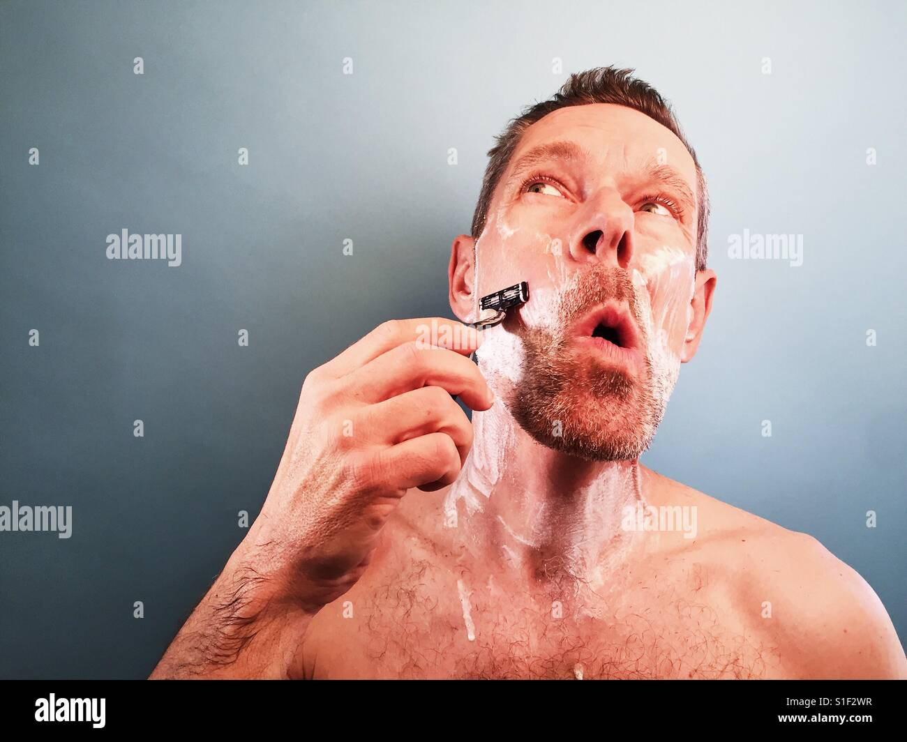 A man shaving - Stock Image