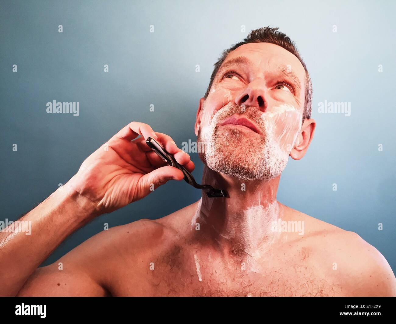 A man shaving - Stock Image