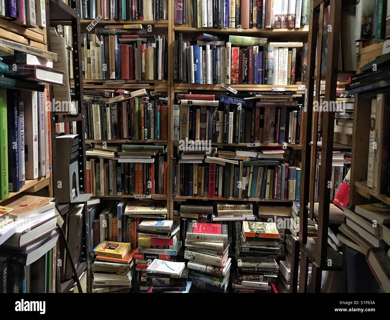 Books stacked up in bookstore Stock Photo