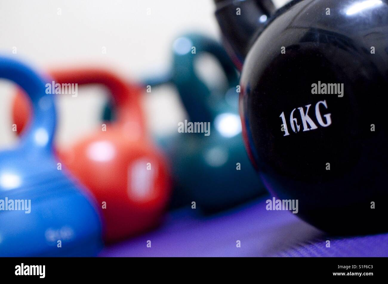 Colorful kettlebells - Stock Image