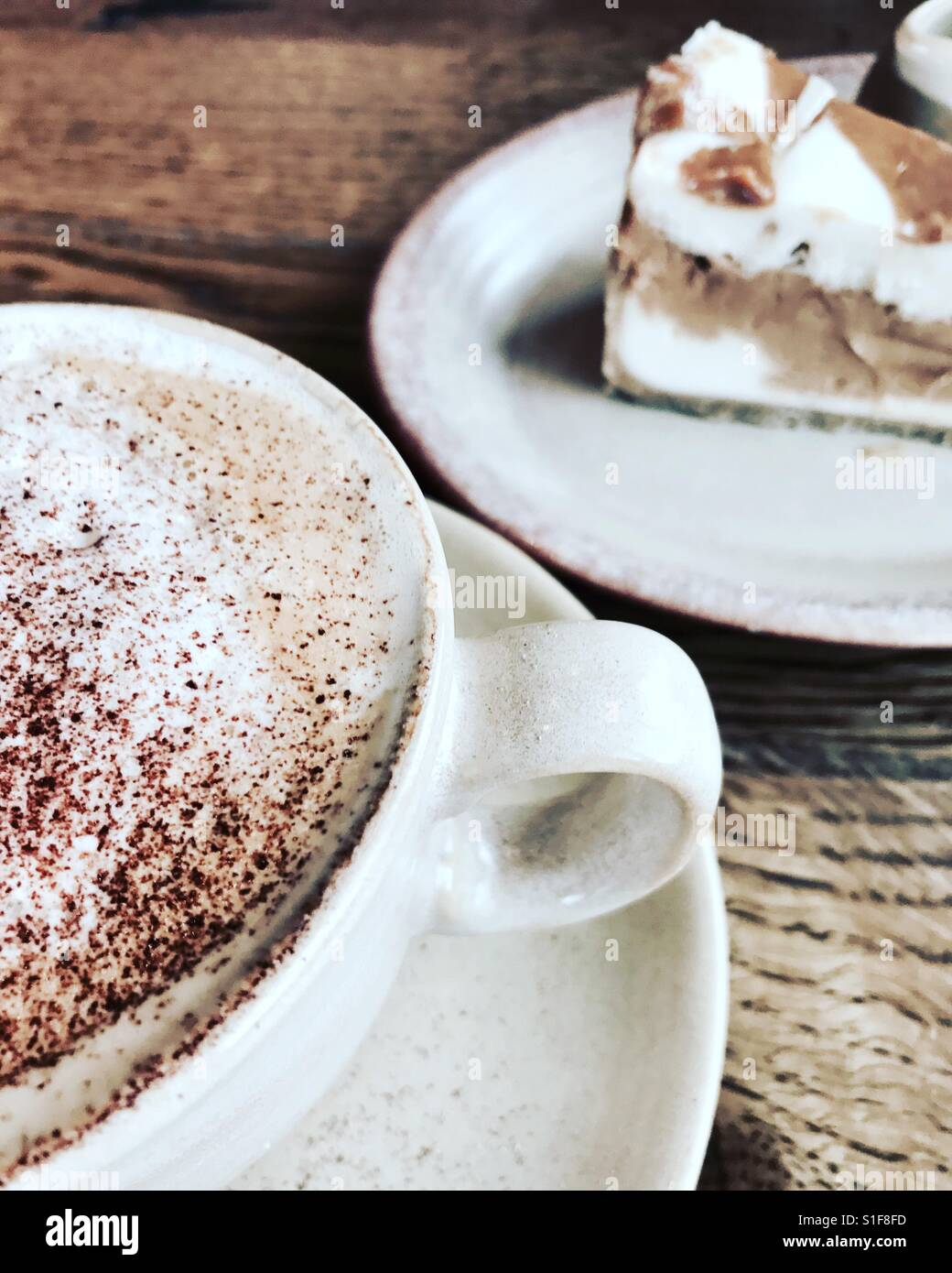 Cappuccino and cheese cake - Stock Image