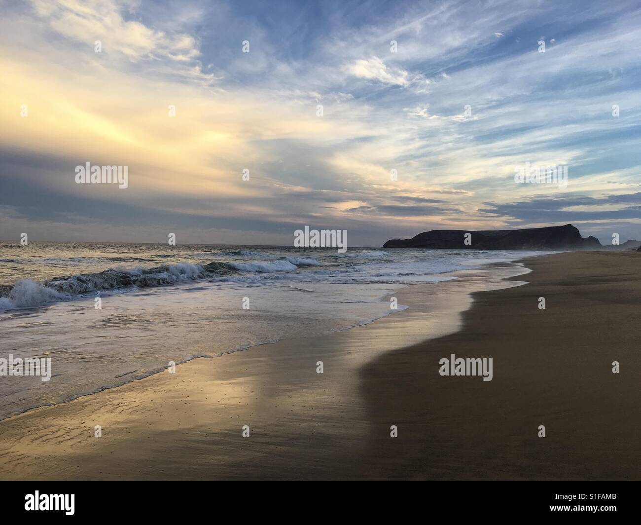 Sunset skies over the beach at Porto Santo, Madeira - Stock Image