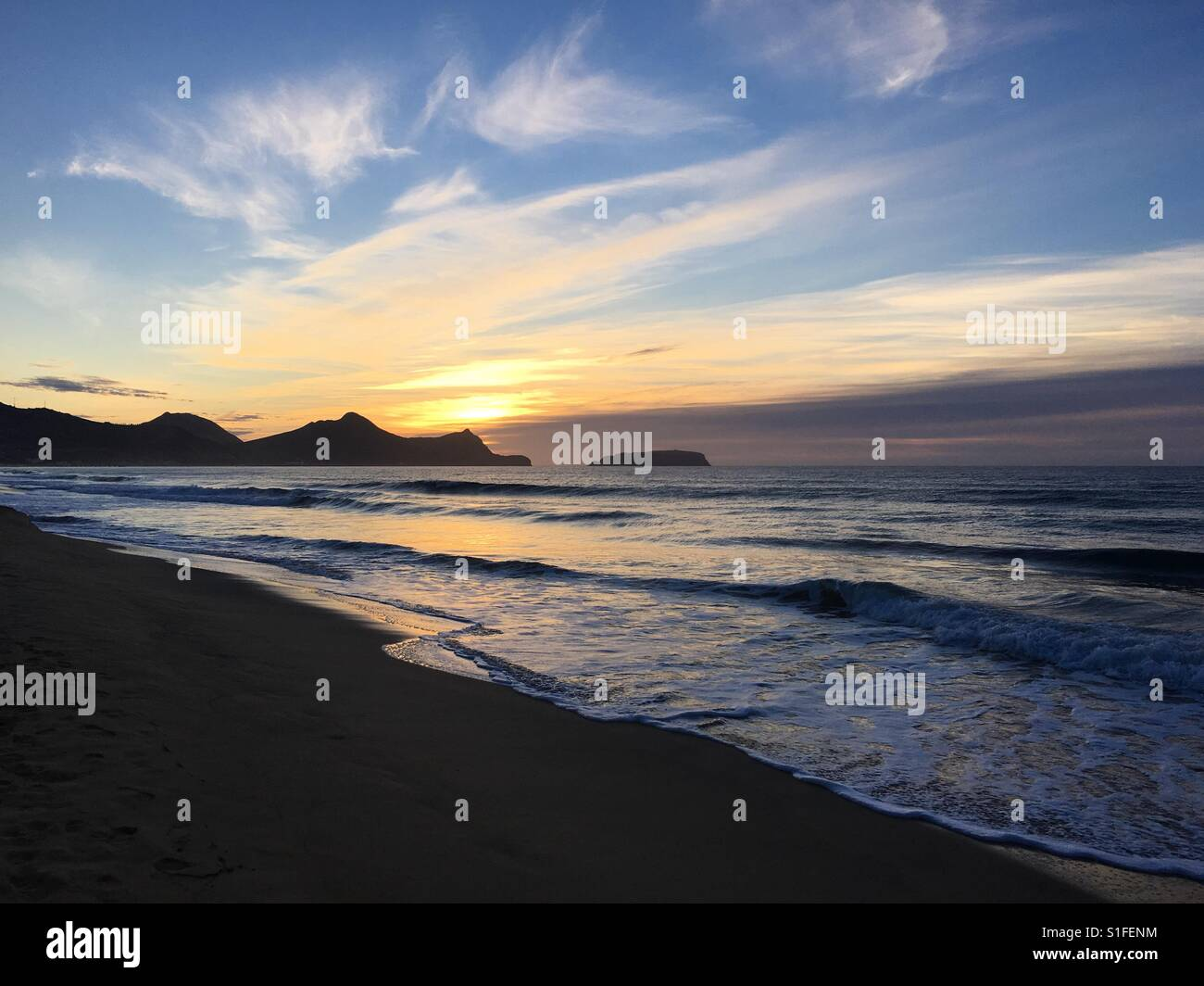 Sunrise over the mountains of Porto Santo Island, Madeira - Stock Image