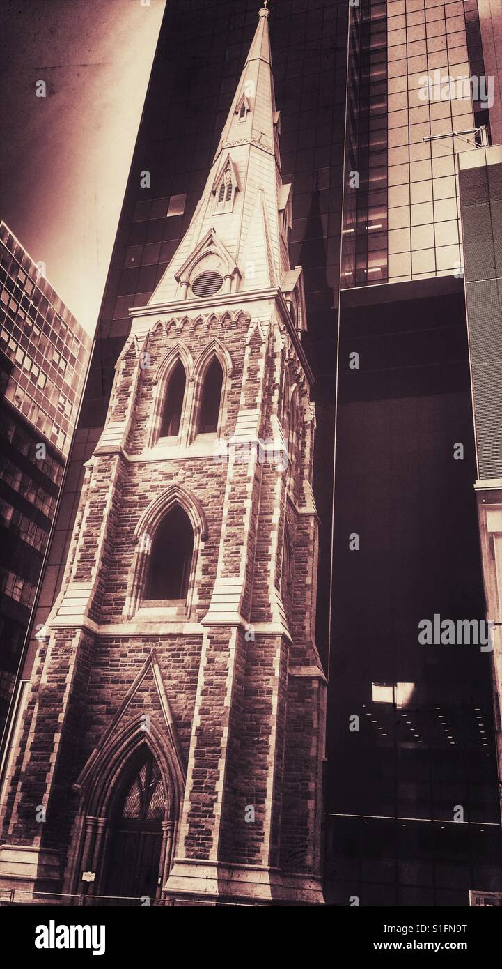 Church beside modern building, Montreal, Quebec, Canada - Stock Image