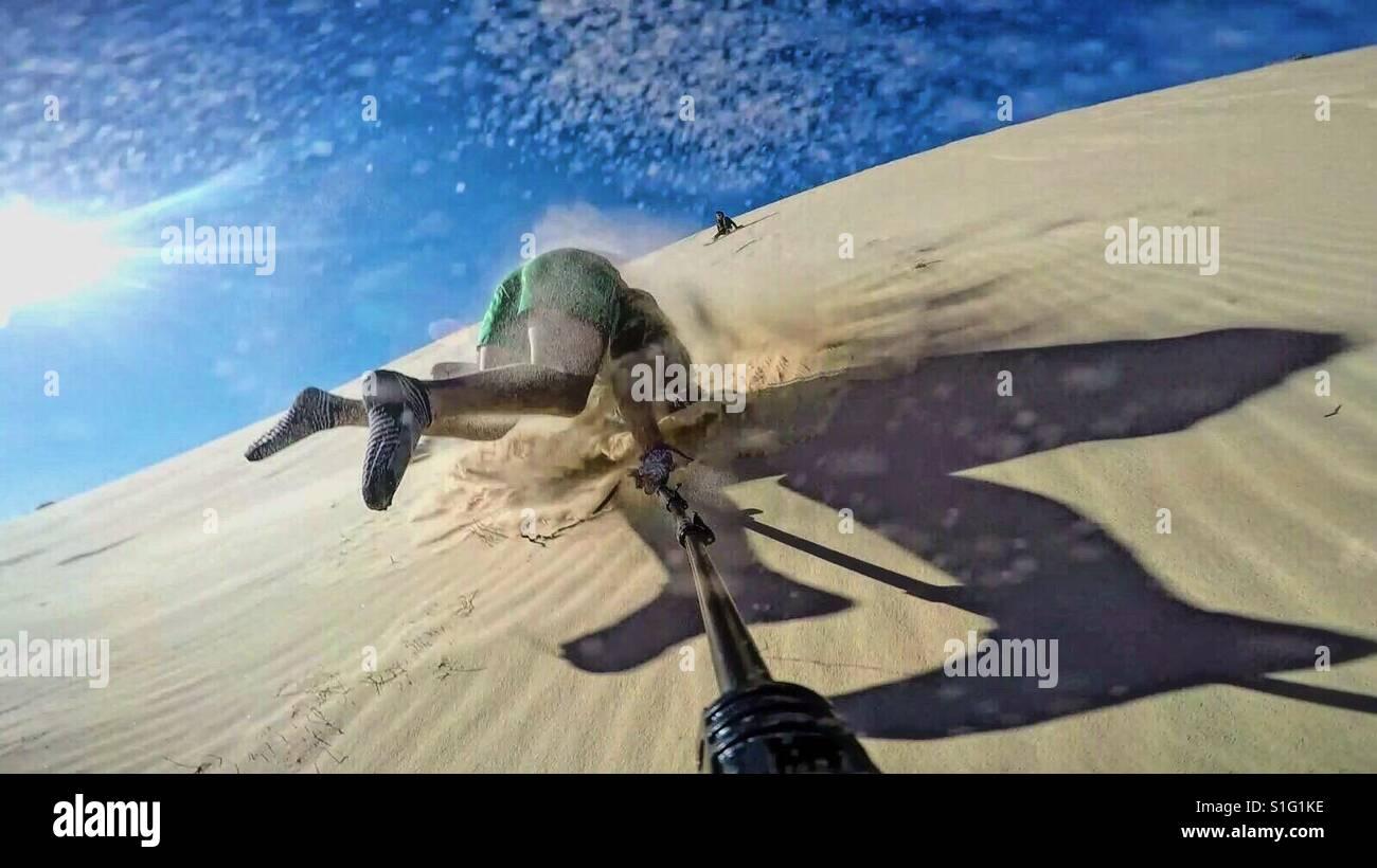 Sand boarding fail - Stock Image