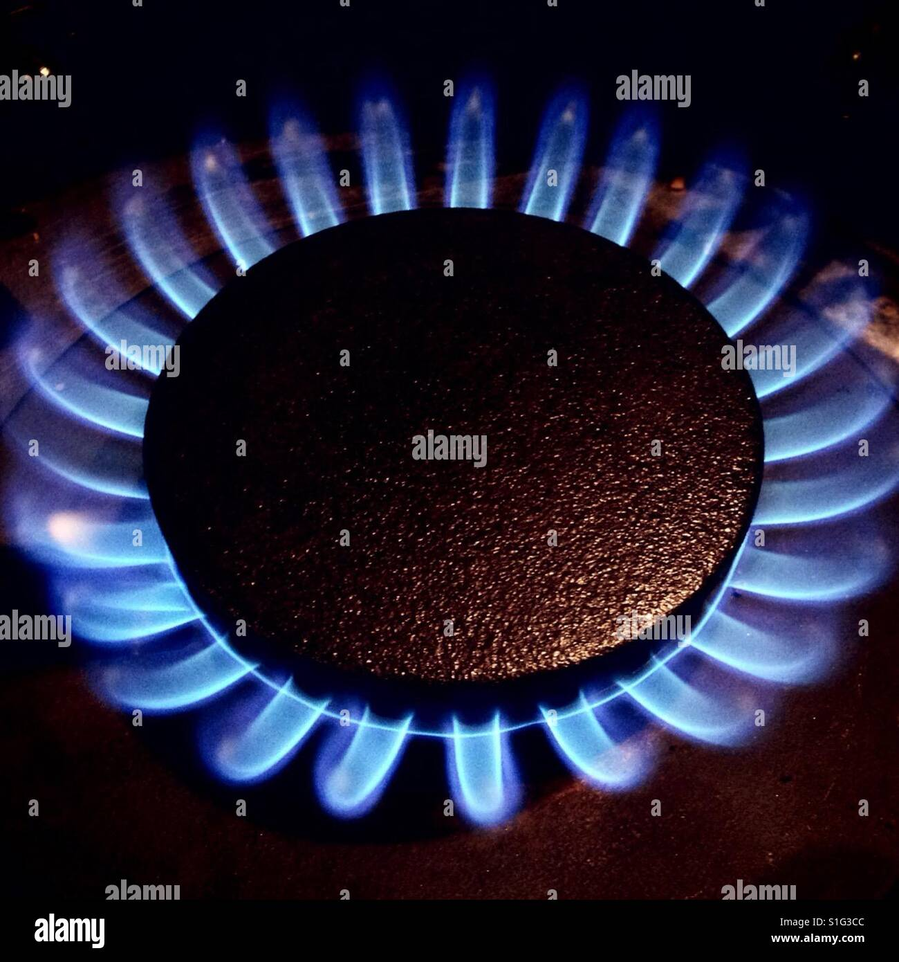 Cooking with gas, gas ring on cooker - Stock Image
