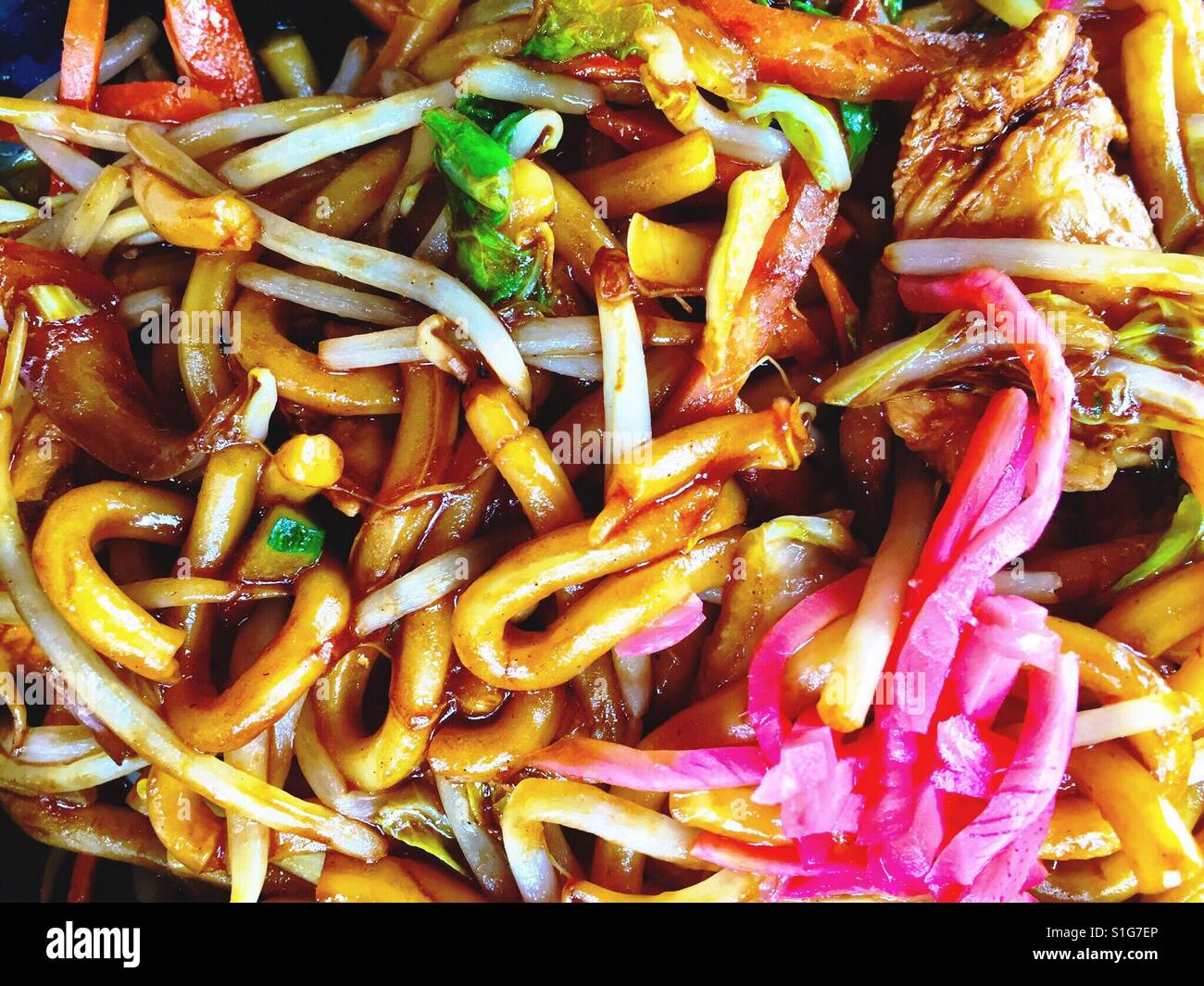 Stir fried chicken with udon noodles and pickled ginger. - Stock Image