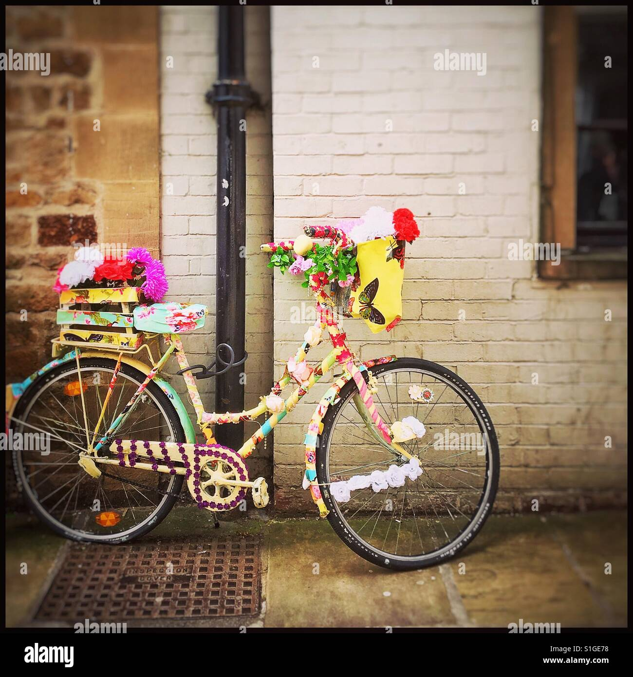 Flowery cycle in Richmond, North Yorkshire. Stock Photo