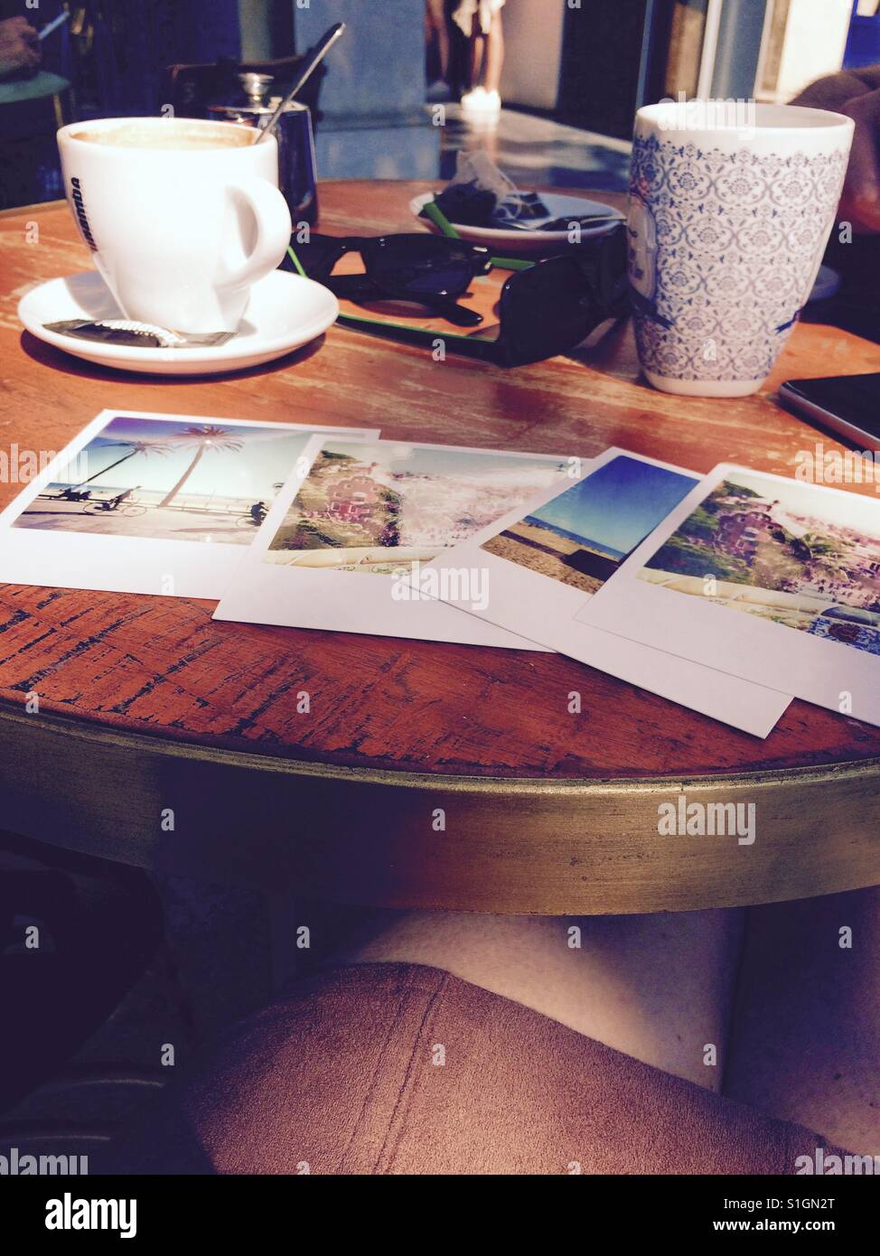 Postcards laid out on a cafe table - Stock Image