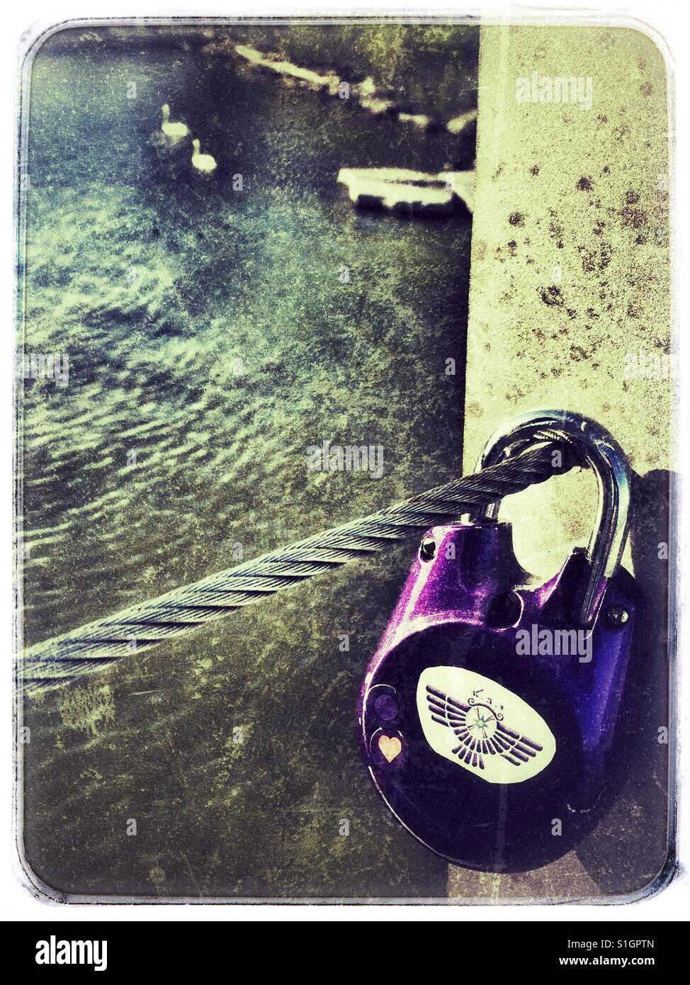 Purple love lock hanging on the Humber Bay bridge in Toronto, Ontario. Stock Photo
