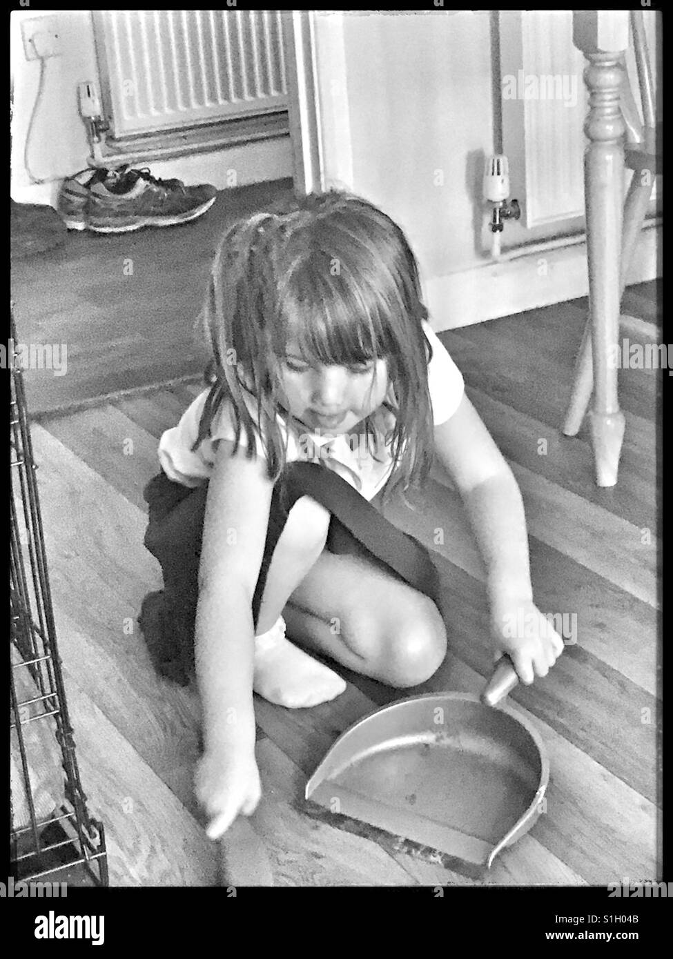 Girl helping with the housework. - Stock Image
