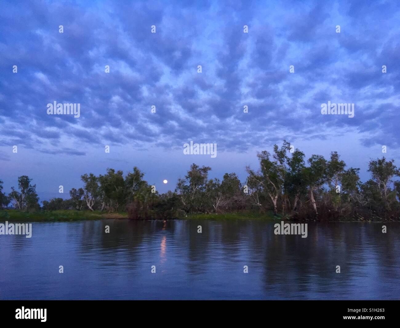Full moon over Corroboree Billabong, near Darwin in the Northern Territory of Australia. - Stock Image
