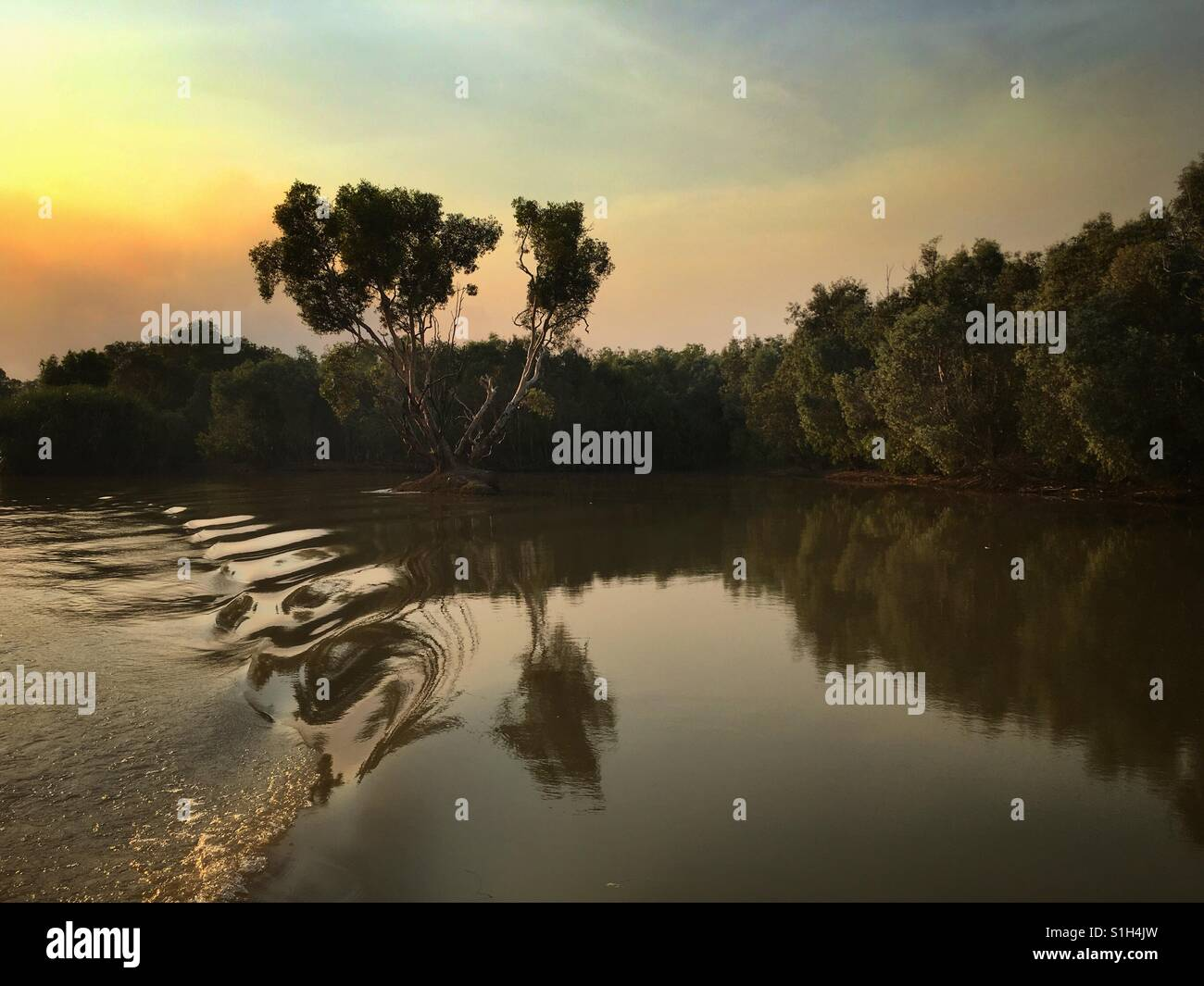 Sunset over Hardie Billabong, near Darwin in the Northern Territory of Australia. - Stock Image
