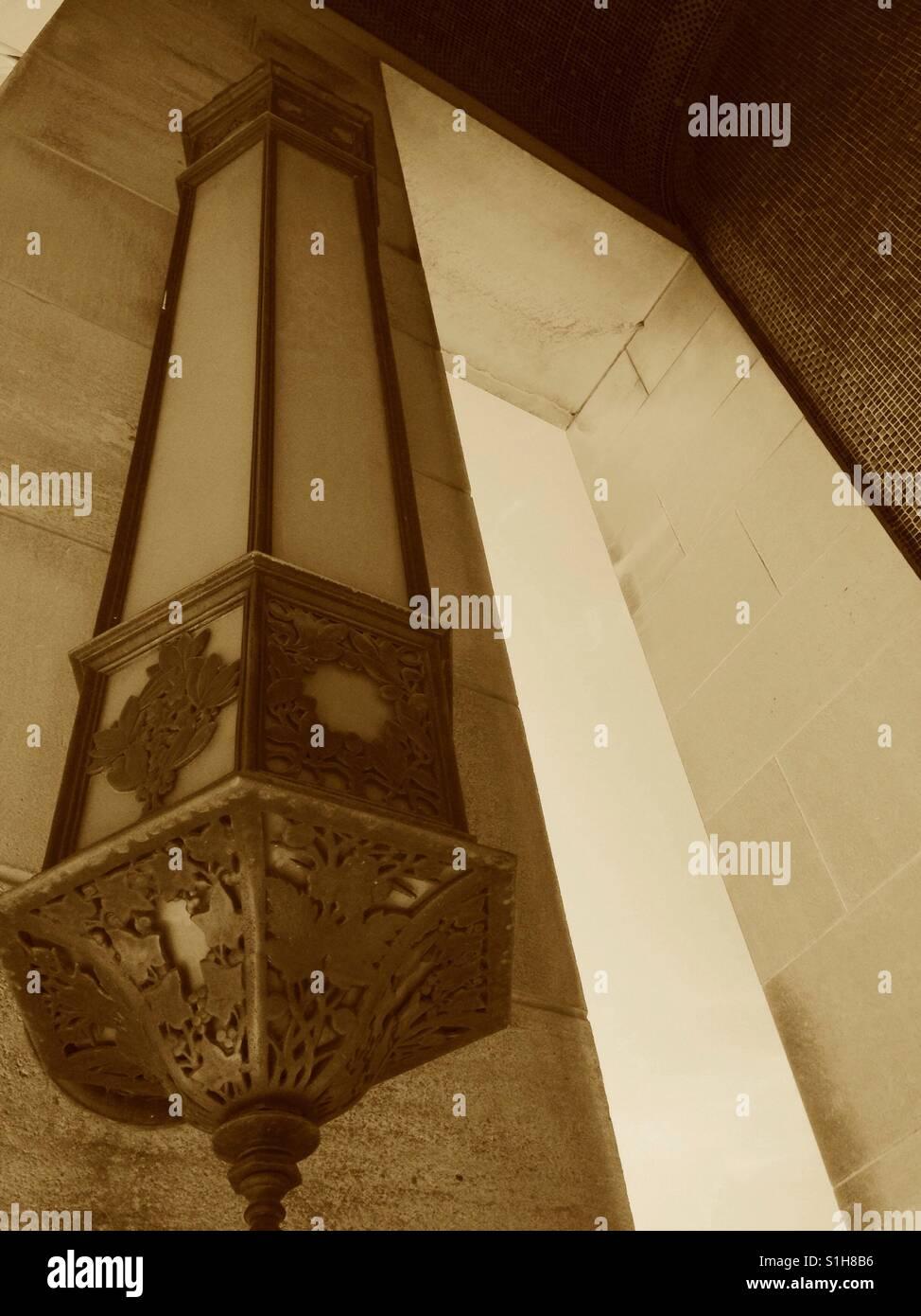 Light fixture and doorways at WWI memorial, Kansas City. Sepia filter applied. - Stock Image