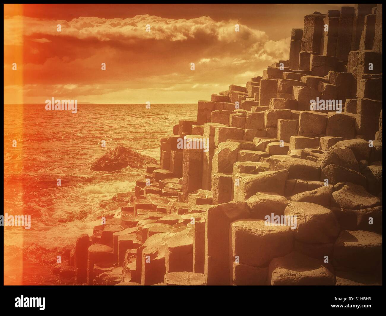 An analogue, film effect image of the famous basalt columns at Giant's Causeway in Co. Antrim, Northern Ireland, - Stock Image