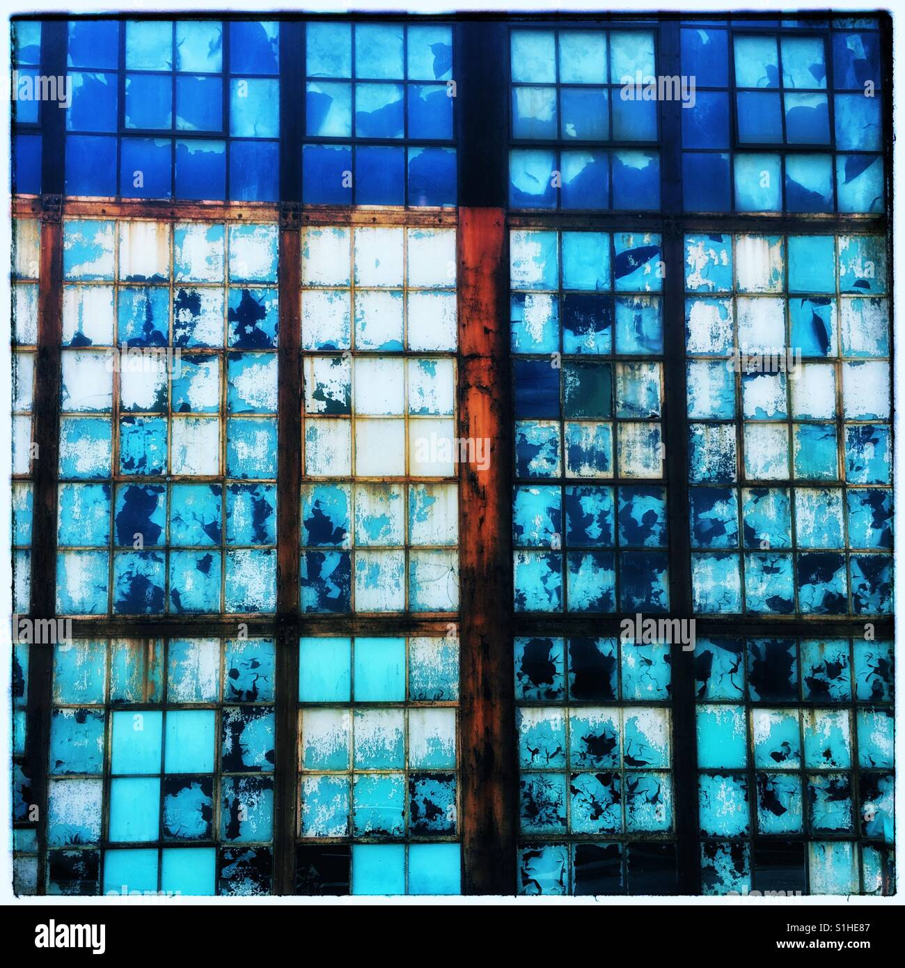 Old window panes painted blue - Stock Image