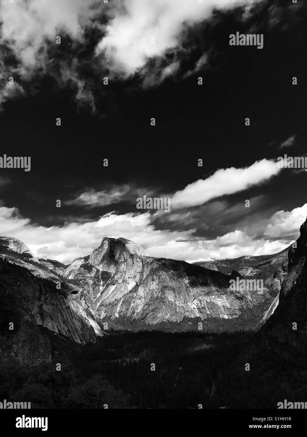 A scenic black and white photo of Half dome and the Yosemite valley. Yosemite national park, California USA. - Stock Image