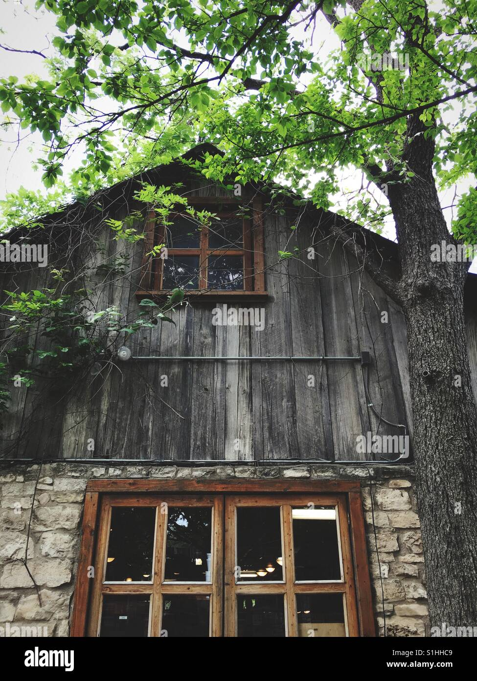 Old rural house made of stone and wood - Stock Image
